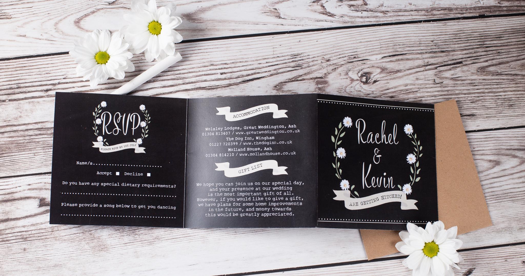 Wedding invite in a chalkboard / blackboard style with daisies